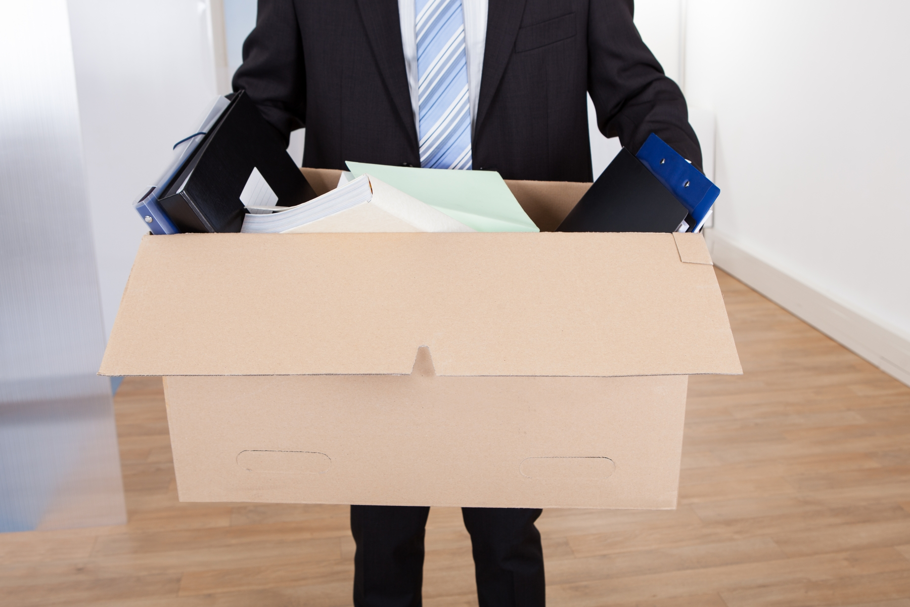 9802512-businessman-moving-out-with-cardboard-box.jpg