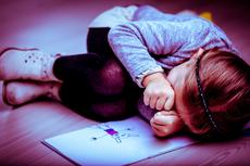 19408160-upset-little-girl-curled-up-next-to-her-drawing.jpg