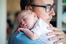 17608419-close-up-of-young-father-holding-his-newborn-baby-son.jpg