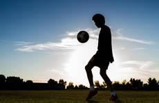 16524412-boy-playing-football.jpg