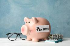 36455836-pension-concept-piggy-bank-calculator-money-and.jpg