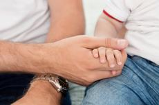3713065-father-holding-child-s-hand.jpg